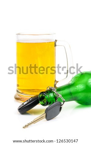 Beer and car keys. The photo on the white background