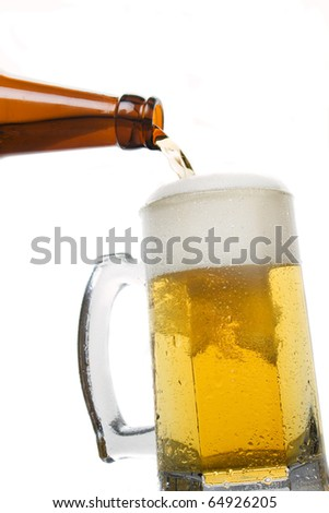 Beer bein poured from the bottle isolated on white