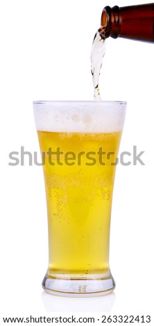Beer into glass isolated on white background.