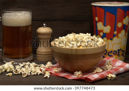Beer with popcorn. Will decorate any holiday: birthday, party or regular dinner.