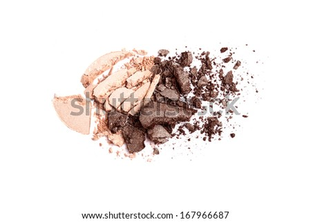 Beige and brown crushed eyeshadow on white background