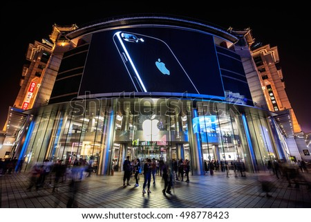 BEIJING, CHINA - OCTOBER 2, 2016: An iPhone 7 is display on a large screen at an Apple Store in Wangfujing Street. Apple's iPhone 7 goes on sale in mainland China from September 16.