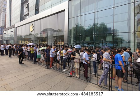 BEIJING, CHINA-SEPTEMBER 16, 2016: People queue outside an Apple Store in Xidan commercial area. Apple's iPhone 7 goes on sale in mainland China from this Friday.