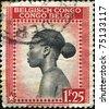 BELGIAN CONGO - CIRCA  1942: A stamp printed in Belgian Congo shows Head of a native woman, circa 1942 - stock photo