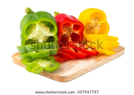 Bell pepper on chopping block isolated on white background