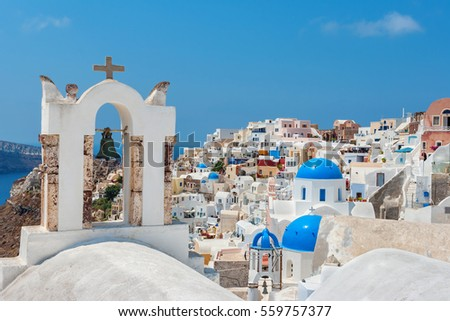 Bell tower and Oia village. Santorini island, Cyclades, Greece