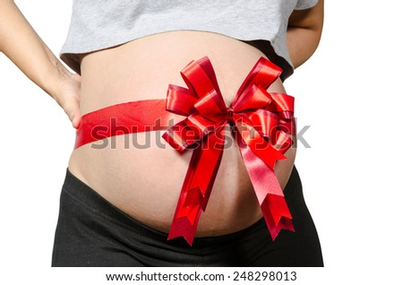 belly of pregnant woman with red ribbon on white background, clipping path.