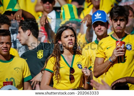 BELO HORIZONTE, BRAZIL - June 28, 2014: Brazil soccer fans hoping for a win at the 2014 World Cup Round of 16 game between Brazil and Chile at Mineirao Stadium. No Use in Brazil.