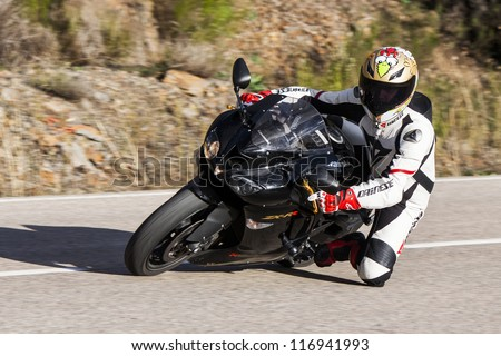 "BEMBIBRE, SPAIN - JUNE 23: Motorcyclist unidentified with Kawasaki Ninja ZX-RR 600 in the 3rd motorcycle rally ""Bierzorros"" in Bembibre (Leon) on June 23, 2012 in Bembibre, Spain."