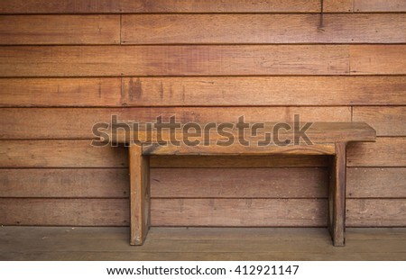 bench with a old wooden wall background