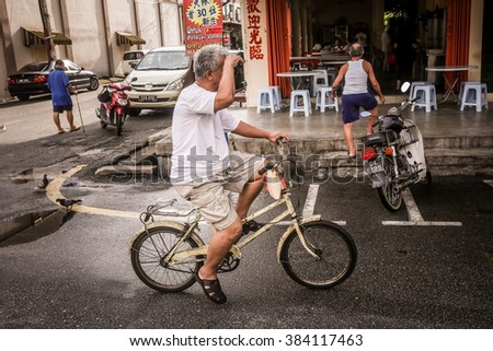 Bentong, Malaysia - 28 February 2016 : Man rides a bicycle in the street of Bentong town in Pahang, under the administration of district of Raub.