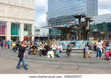 BERLIN, GERMANY - AUGUST 26, 2014: People visit the Alexander Square (Alexanderplatz) in Berlin. Berlin is Germany's largest city with population of 3.5 million.