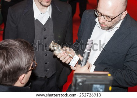 BERLIN, GERMANY - FEBRUARY 14, 2015: Producer Artem Vasiliev winner of the Silver Bear for Outstanding Artistic Contribution for the movie 'Under Electric Clouds'  during the 65th Berlinale