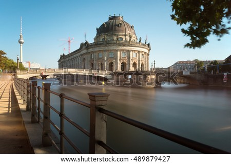 Berlin, Germany. The museum island with the Bode Museum and the tv-tower in the background. Long Exposure. All signs in the photo are signs for navigation on the river.