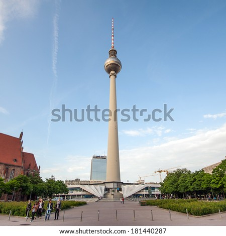 BERLIN - JUNE 3, 2013: Fernsehturm (Television Tower) close to Alexanderplatz. The Fernsehturm is the fourth tallest freestanding structure in Europe with its 368 metres.