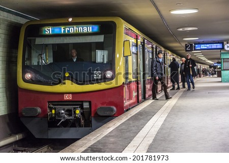 BERLIN - JUNE 5: People at Potsdamer Platz subway station on 5 June 2013 in Berlin, Germany. The Berlin U-Bahn is the most extensive underground network in Germany with a system length of 146 km.