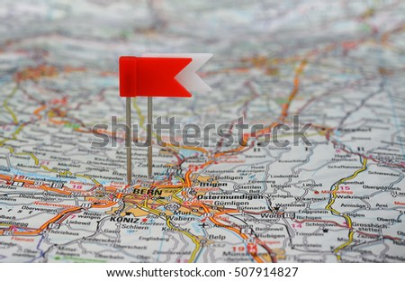 Bern marked with red and white pushpin on swiss map. Selective focus
