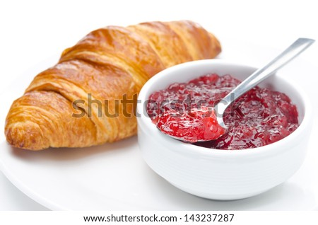 berry jam and croissant on a plate, isolated