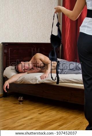 DE husband and wife sleeping naked.
