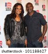 BEVERLY HILLS, CA. - APRIL 24: Boxing legends Laila Ali and Evander Holyfield arrive at the USA boxing benefit at the Paley Center for the Media on April 24 2012 in Beverly Hills. - stock photo
