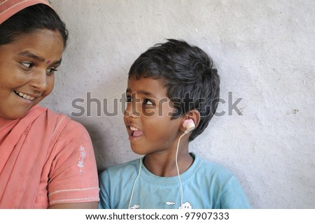 BHOPAL- NOVEMBER 14: 7 years old Lakhan who is deaf from his birth due to alleged chemical contamination to his mother before his birth sharing a laugh in Bhopal - India on November 14, 2010.