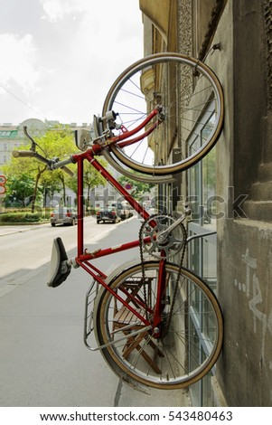 Bicycle hanging on the wall in the street of Vienna