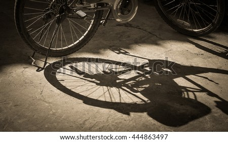 Bicycle parking  shadow on concrete  pavement.