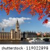 Big Ben with boat in London, England - stock photo