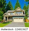 Big custom made double garage luxury house in the suburbs of Vancouver, Canada. - stock photo