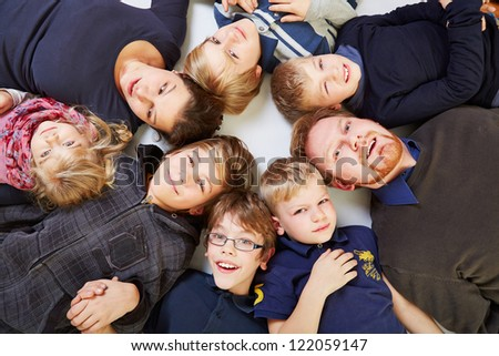 Big family with six kids in a circle looking up