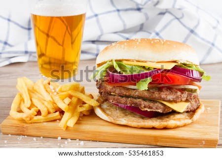 Big fresh  hamburger with french fries and beer