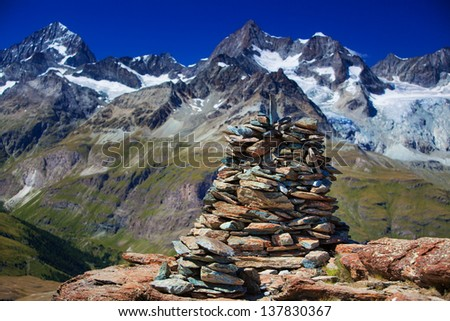 Big hand-made stone tower in Alps.