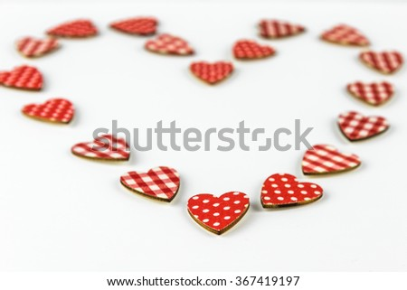 Big heart built from many little hearts for Valentines day in white background