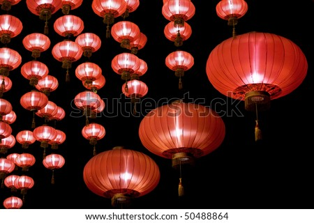 Big red lanterns will bring good luck and peace to prayer. It was at night in a chinese temple during Chinese New Year.