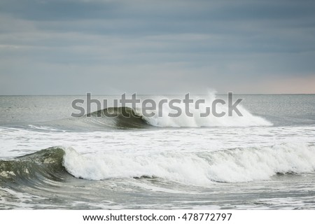 Big waves from the Atlantic Ocean crash along the New Jersey shore after a storm.