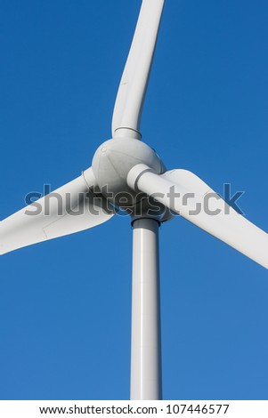 Big white windmill with blue and clear sky