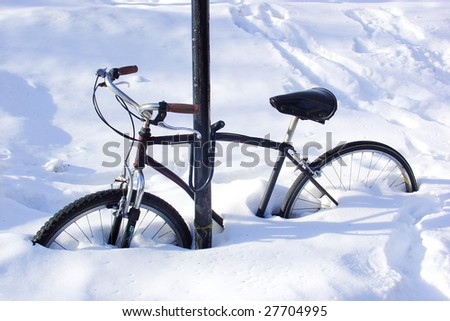 Bike covered by snow