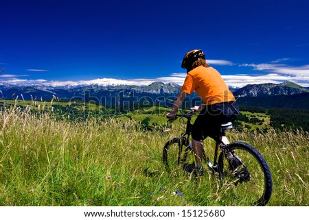 Biker riding in mountains on a sunny day