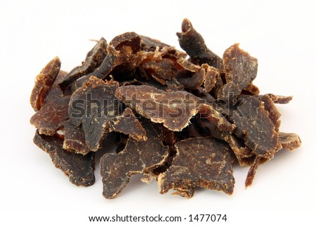Biltong is a healthy low fat, high protein cured dry meat suitable for dieting using sun dried methods of food preservation, isolated on white, shallow dof, macro, close up, on white