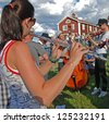 BINGSJO, SWEDEN - JULY 7: Unidentified people in music festival at Bingsjostamman in Bingsjo, official name Bingsjostamman organization are folkmusikens hus on July 7, 2010 in Bingsjo Sweden - stock photo