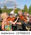 BINGSJO, SWEDEN - JULY 2: Unidentified people in music festival at Bingsjostamman in Bingsjo. Official name Bingsjostamman organization are folkmusikens hus on July 2, 2008 in Bingsjo Sweden - stock photo