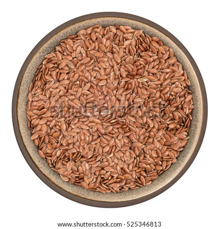 Bio organic flax seeds in ceramic bowl isolated on white background, top view