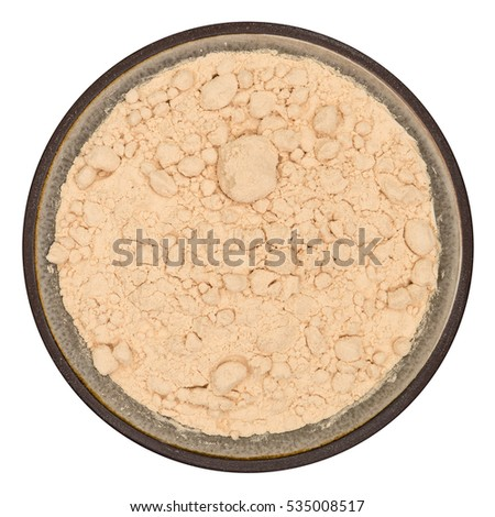 Bio organic pea protein powder in ceramic bowl isolated on white background, top view