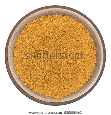 Bio organic ras el hanout royal spice in ceramic bowl isolated on white background, top view