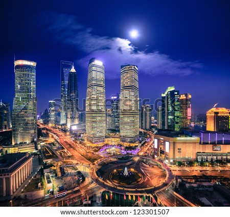bird's eye view of shanghai skyline at night with moonlight