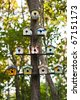 Birdhouses on a tree - stock photo