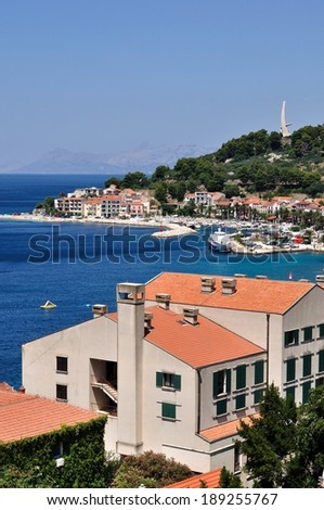 Birdview of Podgora with port and monument Seagull's wings. Croatia. Vertical image