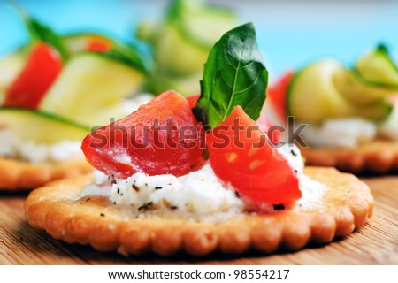 ... with ricotta cheese and tomato garnished with basil - stock photo