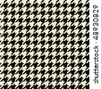 Black and tan colored seamless houndstooth pattern or texture. - stock vector