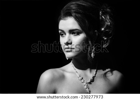 Black and white beauty portrait of young bride. Perfect makeup and hairstyle.